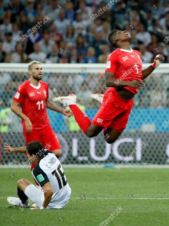 Francois Moubandje (R) of Switzerland in action during the FIFA World Cup 2018 group E preliminary round soccer match between Switzerland and Costa Rica in Nizhny Novgorod, Russia, 27 June 2018. (RESTRICTIONS APPLY: Editorial Use Only, not used in association with any commercial entity - Images must not be used in any form of alert service or push service of any kind including via mobile alert services, downloads to mobile devices or MMS messaging - Images must appear as still images and must not emulate match action video footage - No alteration is made to, and no text or image is superimposed over, any published image which: (a) intentionally obscures or removes a sponsor identification image; or (b) adds or overlays the commercial identification of any third party which is not officially associated with the FIFA World Cup)