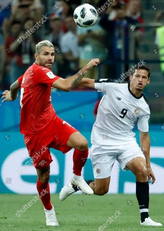 Daniel Colindres (R) of Costa Rica and Valon Behrami of Switzerland in action during the FIFA World Cup 2018 group E preliminary round soccer match between Switzerland and Costa Rica in Nizhny Novgorod, Russia, 27 June 2018. (RESTRICTIONS APPLY: Editorial Use Only, not used in association with any commercial entity - Images must not be used in any form of alert service or push service of any kind including via mobile alert services, downloads to mobile devices or MMS messaging - Images must appear as still images and must not emulate match action video footage - No alteration is made to, and no text or image is superimposed over, any published image which: (a) intentionally obscures or removes a sponsor identification image; or (b) adds or overlays the commercial identification of any third party which is not officially associated with the FIFA World Cup)