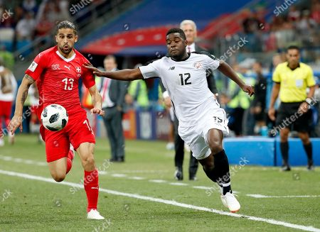 Ricardo Rodriguez (L) of Switzerland and Rodney Wallace of Costa Rica in action during the FIFA World Cup 2018 group E preliminary round soccer match between Switzerland and Costa Rica in Nizhny Novgorod, Russia, 27 June 2018.