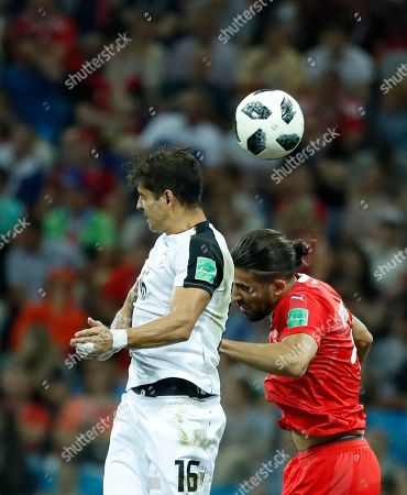Cristian Gamboa (L) of Costa Rica and Ricardo Rodriguez of Switzerland in action during the FIFA World Cup 2018 group E preliminary round soccer match between Switzerland and Costa Rica in Nizhny Novgorod, Russia, 27 June 2018.