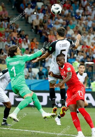 Celso Borges of Costa Rica goes for a header during the FIFA World Cup 2018 group E preliminary round soccer match between Switzerland and Costa Rica in Nizhny Novgorod, Russia, 27 June 2018. (RESTRICTIONS APPLY: Editorial Use Only, not used in association with any commercial entity - Images must not be used in any form of alert service or push service of any kind including via mobile alert services, downloads to mobile devices or MMS messaging - Images must appear as still images and must not emulate match action video footage - No alteration is made to, and no text or image is superimposed over, any published image which: (a) intentionally obscures or removes a sponsor identification image; or (b) adds or overlays the commercial identification of any third party which is not officially associated with the FIFA World Cup)