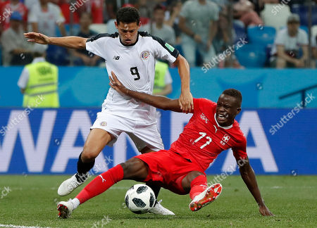 Stock Photo of Costa Rica's Daniel Colindres, left, and Switzerland's Denis Zakaria fight for the ball during the group E match between Switzerland and Costa Rica, at the 2018 soccer World Cup in the Nizhny Novgorod Stadium in Nizhny Novgorod, Russia