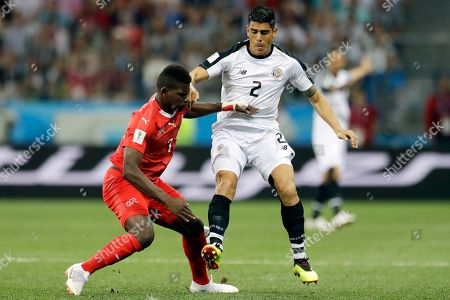 Stock Picture of Switzerland's Breel Embolo, left, and Costa Rica's Johnny Acosta fight for the ball during the group E match between Switzerland and Costa Rica, at the 2018 soccer World Cup in the Nizhny Novgorod Stadium in Nizhny Novgorod, Russia