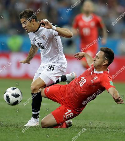 Costa Rica's Cristian Gamboa, left, and Switzerland's Mario Gavranovic fight for the ball during the group E match between Switzerland and Costa Rica, at the 2018 soccer World Cup in the Nizhny Novgorod Stadium in Nizhny Novgorod, Russia