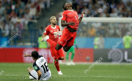 Costa Rica's Cristian Gamboa, left, and Switzerland's Breel Embolo fight for the ball during the group E match between Switzerland and Costa Rica, at the 2018 soccer World Cup in the Nizhny Novgorod Stadium in Nizhny Novgorod, Russia
