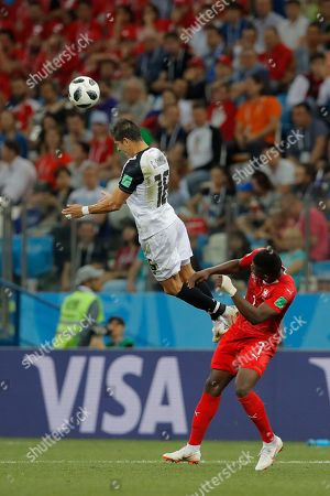 Costa Rica's Cristian Gamboa, top, out jumps Switzerland's Breel Embolo during the group E match between Switzerland and Costa Rica at the 2018 soccer World Cup in the Nizhny Novgorod Stadium in Nizhny Novgorod, Russia, . The match ended in a 2-2 draw
