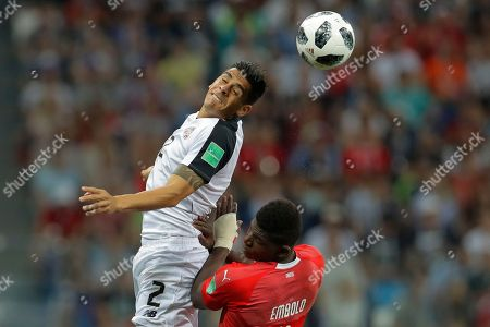 Stock Image of Costa Rica's Johnny Acosta, top, out jumps Switzerland's Breel Embolo during the group E match between Switzerland and Costa Rica at the 2018 soccer World Cup in the Nizhny Novgorod Stadium in Nizhny Novgorod, Russia