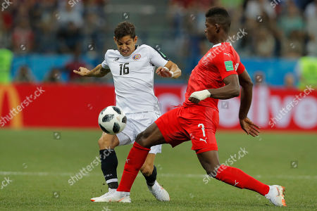 Costa Rica's Cristian Gamboa, left, vies for the ball with Switzerland's Breel Embolo during the group E match between Switzerland and Costa Rica at the 2018 soccer World Cup in the Nizhny Novgorod Stadium in Nizhny Novgorod, Russia