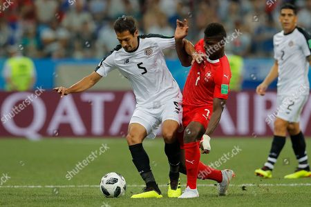 Costa Rica's Celso Borges, left, vies for the ball with Switzerland's Breel Embolo during the group E match between Switzerland and Costa Rica at the 2018 soccer World Cup in the Nizhny Novgorod Stadium in Nizhny Novgorod, Russia