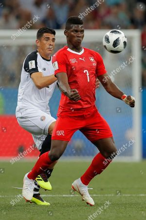 Switzerland's Breel Embolo, right, and Costa Rica's Johnny Acosta fight for the ball during the group E match between Switzerland and Costa Rica at the 2018 soccer World Cup in the Nizhny Novgorod Stadium in Nizhny Novgorod, Russia