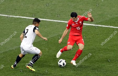 Costa Rica's Johnny Acosta, left, vies for the ball with Switzerland's Blerim Dzemaili during the group E match between Switzerland and Costa Rica, at the 2018 soccer World Cup in the Nizhny Novgorod Stadium in Nizhny Novgorod, Russia
