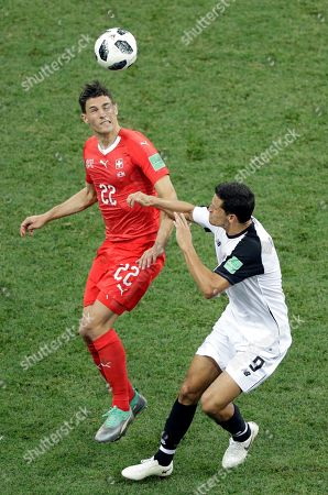 Switzerland's Fabian Schaer, left, vies for the ball with Costa Rica's Daniel Colindres during the group E match between Switzerland and Costa Rica, at the 2018 soccer World Cup in the Nizhny Novgorod Stadium in Nizhny Novgorod, Russia