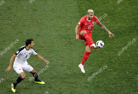 Switzerland's Valon Behrami controls the ball in front of Costa Rica's Celso Borges during the group E match between Switzerland and Costa Rica, at the 2018 soccer World Cup in the Nizhny Novgorod Stadium in Nizhny Novgorod, Russia