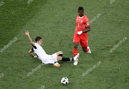 Costa Rica's Cristian Gamboa, left, fouls Switzerland's Breel Embolo during the group E match between Switzerland and Costa Rica, at the 2018 soccer World Cup in the Nizhny Novgorod Stadium in Nizhny Novgorod, Russia