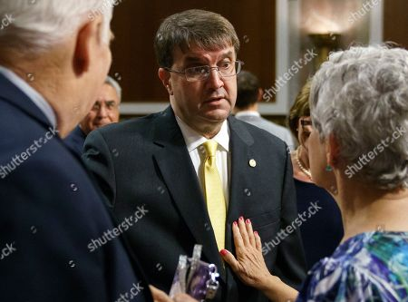Stock Photo of Robert Wilkie, John Wells, Susan Belanger. Veterans Affairs Secretary nominee Robert Wilkie, center, talks with John Wells, left, and Susan Belanger, both of Military Veterans Advocacy, before the start of a Senate Veterans Affairs Committee nominations hearing on Capitol Hill in Washington