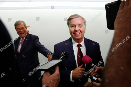 Stock Picture of Lindsey Graham, Trent Lott. Sen. Lindsey Graham, R-S.C., right, jokes with former Sen. Trent Lott, R-Miss., left, before answering reporters questions about the retirement of Supreme Court Justice Anthony Kennedy, on Capitol Hill in Washington