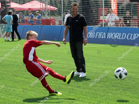German soccer player Lothar Matthaus watches as a member of one of the teams kicks a ball prior to a friendly soccer match between two children teams and FIFA legends at Football Park in Red Square during the 2018 soccer World Cup in Moscow, Russia