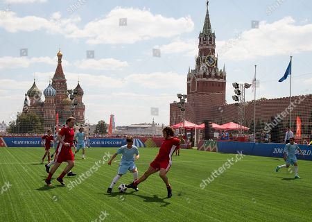 Former player of the Spanish national soccer team Carles Puyol, center, attends a friendly soccer match between two children teams and FIFA legends at Football Park in Red Square during the 2018 soccer World Cup in Moscow, Russia