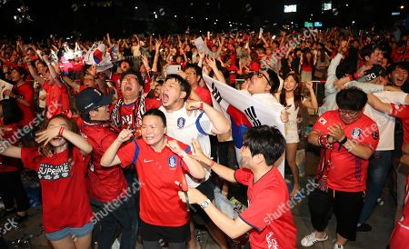 South Koreans rejoice in central Seoul, South Korea, 27 June 2018, as defender Kim Young-gwon nets a goal in South Korea's FIFA World Cup 2018 group F preliminary round soccer match against Germany at Kazan Arena in Kazan, Russia. South Korea beat the defending champions but failed to join the last 16.