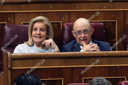 Former Spanish Treasure Minister Cristobal Montoro (R) and former Labour Minister Fatima Banez attend the plenary session to debate and vote the 44 amendments to National Budget draft bill proposed by Upper Chamber's senators at Lower Chamber of Spanish Parliament, in Madrid, Spain, 28 June 2018.
