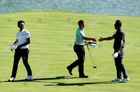 Paul Dunne of Ireland shakes hands with Trevor Immelman of South Africa after their round.