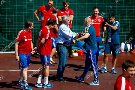 Russia head coach Stanislav Cherchesov, right, welcomes former Russian national soccer coach Guus Hiddink during the official training session of the Russian team prior to the round of 16 match between Russia and Spain at the 2018 soccer World Cup at the Federal Sports Centre Novogorsk, near Moscow, Russia