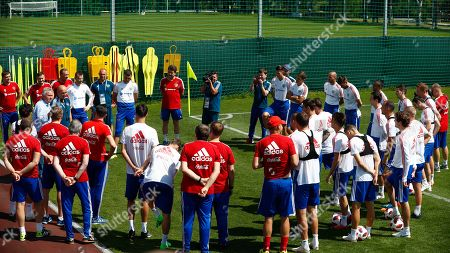 Stock Photo of Former Russian national soccer coach Guus Hiddink, left, talks to players besides Russia head coach Stanislav Cherchesov during the official training session of the Russian team prior to the round of 16 match between Russia and Spain at the 2018 soccer World Cup at the Federal Sports Centre Novogorsk, near Moscow, Russia
