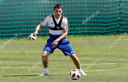 Russia's Alan Dzagoev controls the ball during the official training session of the Russian team prior to the round of 16 match between Russia and Spain at the 2018 soccer World Cup at the Federal Sports Centre Novogorsk, near Moscow, Russia