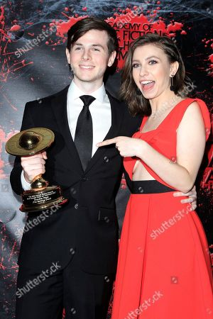 Chandler Riggs, Katelyn Nacon in the press room at the 44th Annual Saturn Awards held at The Castaway in Burbank, California, USA, 27 June 2018 (issued 28 June). The Saturn Awards honors the best in science fiction, fantasy, horror and other genres in film, television, home media releases, and theatre.