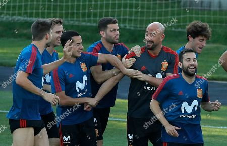 Spain goalkeeper Pepe Reina, center right, jokes with his teammates during a training session of Spain at the 2018 soccer World Cup in Krasnodar, Russia