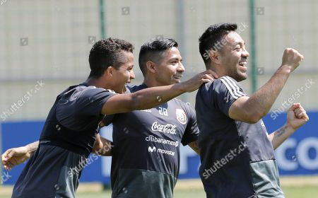 (L-R) Mexico's players Giovani dos Santos, Carlos Salcedo and Marco Fabian enjoy themselves during a training session held in Moscow, Russia, 28 June 2018. Mexico will face Brazil in their 2018 FIFA 2018 World Cup round of 16 soccer match on 02 July 2018.