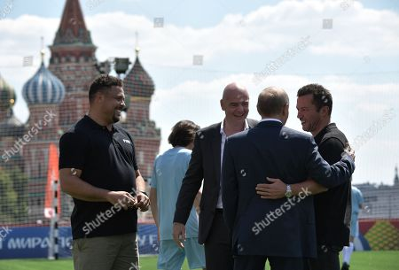 Russian President Vladimir Putin (2-R) hugs  German football player Lothar Matthaus (R), as  FIFA president Gianni Infantino (3-R) and former Brazilian football player Ronaldo (L) look on, as they visit the themed 2018 FIFA World Cup Football Park on Red Square in Moscow, Russia, 28 June 2018.