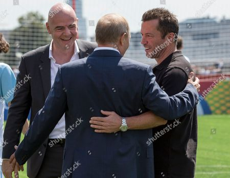 Russia's President Vladimir Putin (C), FIFA President Gianni Infantino (L)  and German soccer player Lothar Matthaus (R) speak to each other during an opening friendly soccer match between two children teams and FIFA legends at a Football Park in Red Square during the 2018 soccer World Cup in Moscow, Russia, 28 June 2018.