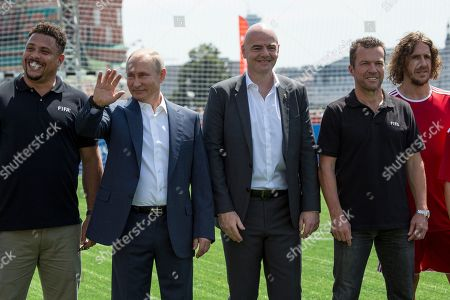 Former Brazilian football player Ronaldo (L), Russia's President Vladimir Putin (2-L), FIFA President Gianni Infantino (3-R), former German soccer player Lothar Matthaeus (2-R) and former player of the Spanish national soccer team Carles Puyol (R) pose for a photo as they attend an opening friendly soccer match between two children teams and FIFA legends at a Football Park in Red Square during the 2018 soccer World Cup in Moscow, Russia, 28 June 2018.