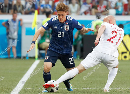 Japan's Gotoku Sakai, left, and Poland's Rafal Kurzawa vie for the ball during the group H match between Japan and Poland at the 2018 soccer World Cup at the Volgograd Arena in Volgograd, Russia