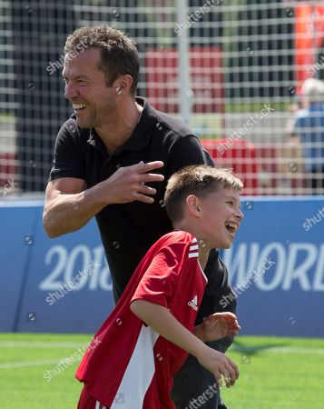 German soccer legend Lothar Matthaus smiles as he speaks to a young player prior to a friendly soccer match between two children teams and FIFA legends at Football Park in Red Square during the FIFA World Cup 2018  in Moscow, Russia, 28 June  2018.