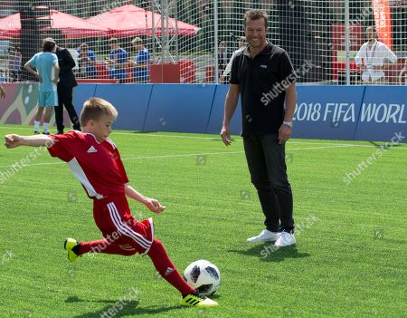 German soccer legend Lothar Matthaus looks at a young player prior to a friendly soccer match between two children teams and FIFA legends at Football Park in Red Square during the FIFA World Cup 2018  in Moscow, Russia, 28 June  2018.