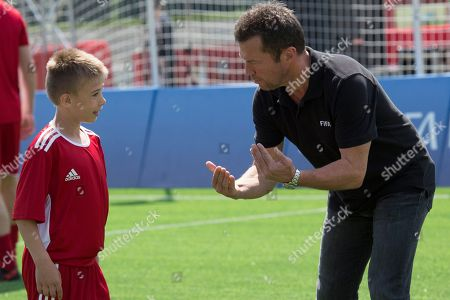 German soccer legend Lothar Matthaus smiles while speaking to a young player prior to a friendly soccer match between two children teams and FIFA legends at Football Park in Red Square during the FIFA World Cup 2018  in Moscow, Russia, 28 June  2018.