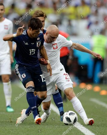Japan's Hiroki Sakai, left, and Poland's Rafal Kurzawa fight for the ball during the group H match between Japan and Poland at the 2018 soccer World Cup at the Volgograd Arena in Volgograd, Russia