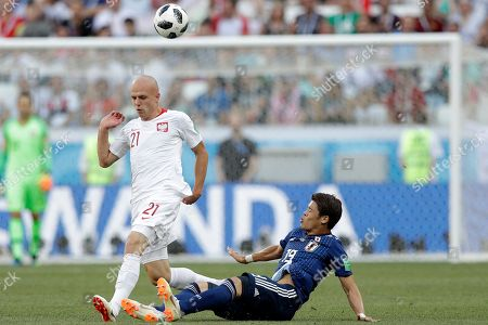 Japan's Hiroki Sakai, right, and Poland's Rafal Kurzawa fight for the ball during the group H match between Japan and Poland at the 2018 soccer World Cup at the Volgograd Arena in Volgograd, Russia