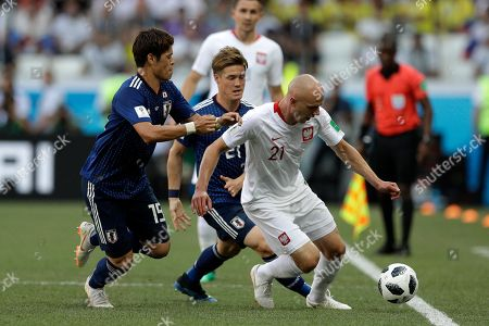Japan's Hiroki Sakai, left, tries to stop Poland's Rafal Kurzawa during the group H match between Japan and Poland at the 2018 soccer World Cup at the Volgograd Arena in Volgograd, Russia