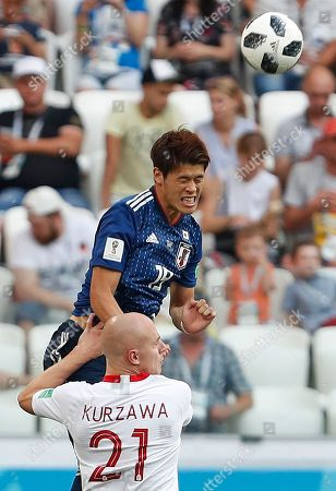 Japan's Hiroki Sakai gets above Poland's Rafal Kurzawa during the group H match between Japan and Poland at the 2018 soccer World Cup at the Volgograd Arena in Volgograd, Russia