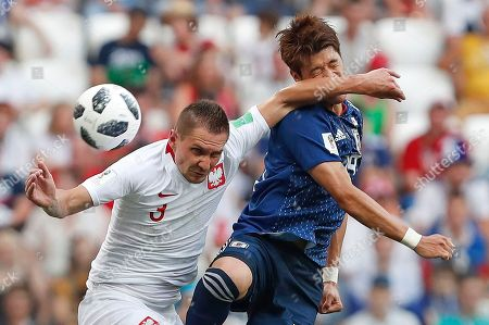 Poland's Artur Jedrzejczyk, left, challenges Japan's Hiroki Sakai during the group H match between Japan and Poland at the 2018 soccer World Cup at the Volgograd Arena in Volgograd, Russia