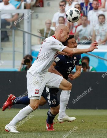 Rafal Kurzawa of Poland and Shinji Okazaki of Japan