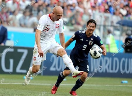Shinji Okazaki of Japan and Rafal Kurzawa of Poland