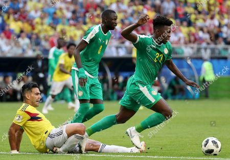 Radamel Falcao (L) of Colombia tackles Lamine Gassama of Senegal during the FIFA World Cup 2018 group H preliminary round soccer match between Senegal and Colombia in Samara, Russia, 28 June 2018.