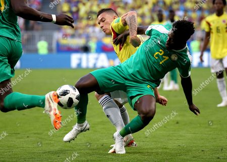 Mateus Uribe of Colombia and Lamine Gassama of Senegal