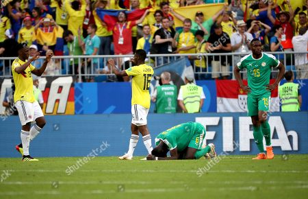 Yerry Mina of Colombia, Jefferson Lerma of Colombia, Salif Sane of Senegal and Diafra Sakho of Senegal