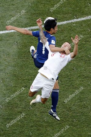 Japan's Gaku Shibasaki fights for the ball with Poland's Jacek Goralski, right, during the group H match between Japan and Poland at the 2018 soccer World Cup at the Volgograd Arena in Volgograd, Russia