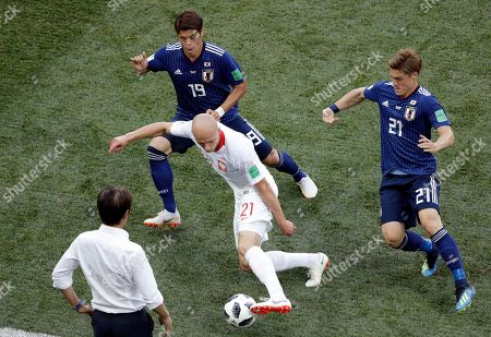 Poland's Rafal Kurzawa controls the ball between Japan's Hiroki Sakai and Japan's Gotoku Sakai, right, during the group H match between Japan and Poland at the 2018 soccer World Cup at the Volgograd Arena in Volgograd, Russia